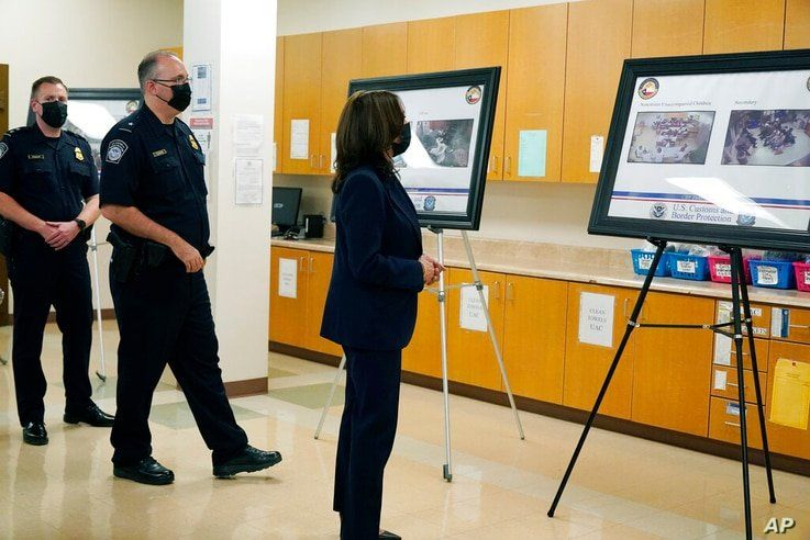 Vice President Kamala Harris looks at photos as she visits the Paso del Norte (PDN) Port of Entry in El Paso, Texas, Friday,…