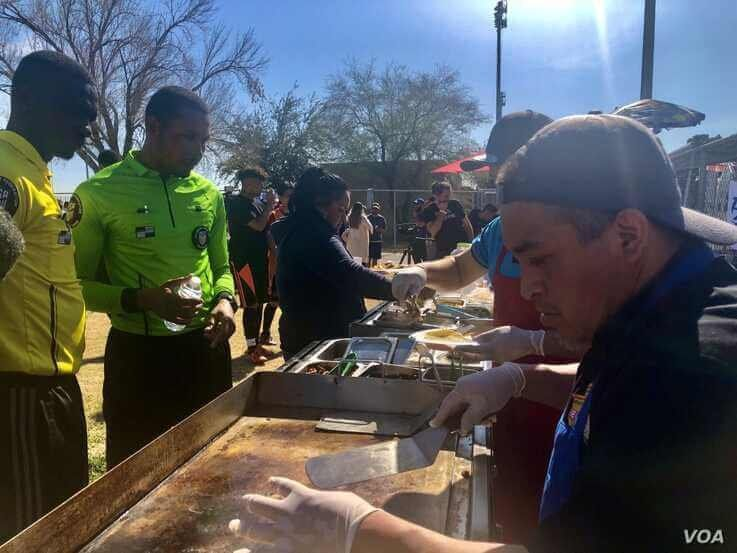 Soccer players wait for tacos at a Latino soccer tournament sponsored by Senator Bernie Sanders. (Carolyn Presutti/VOA)