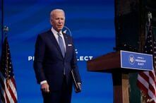 President-elect Joe Biden pauses as he leaves to listen to a reporter's shouted question at The Queen Theater in Wilmington,…