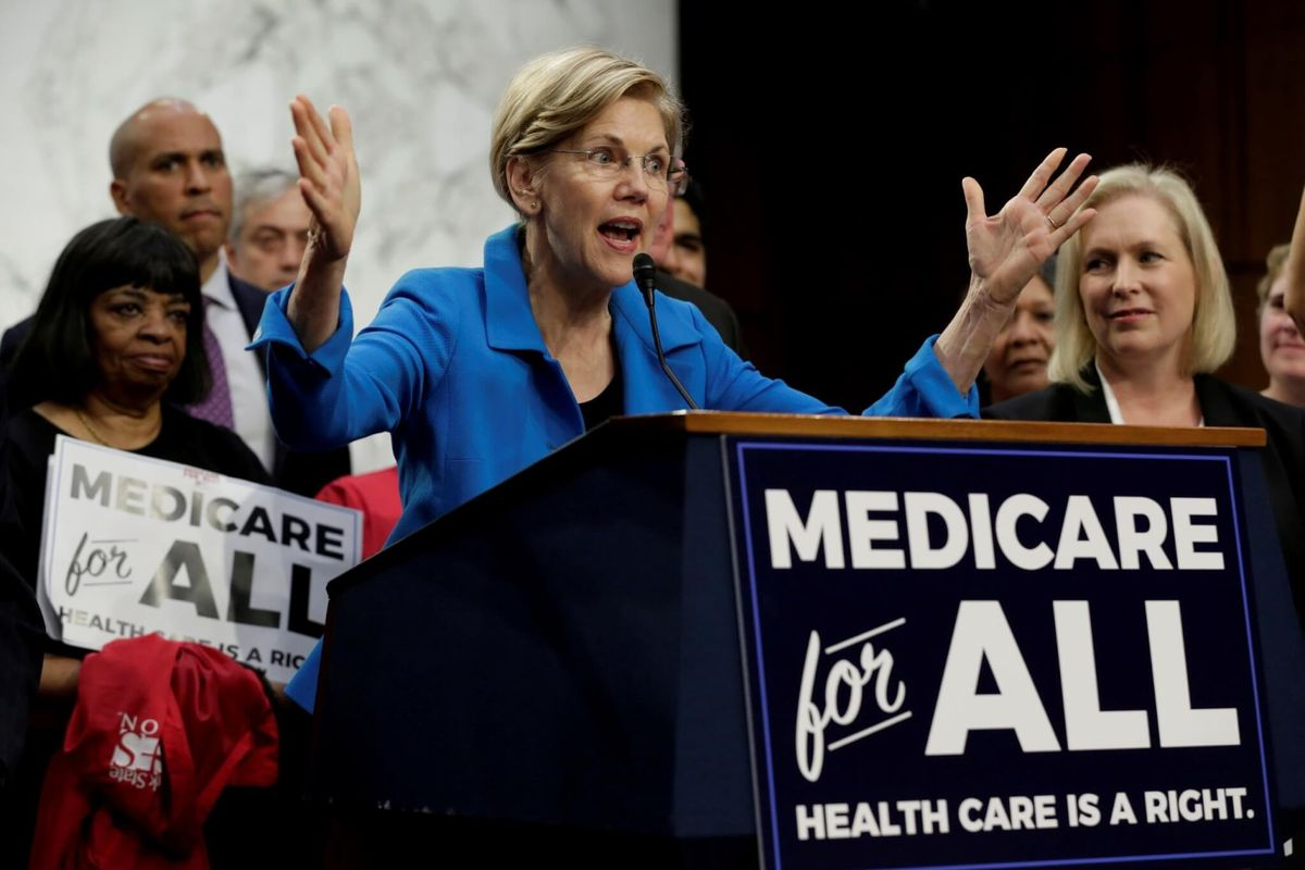 Democrat Warren Outlines Three-Year Path to Medicare for All
