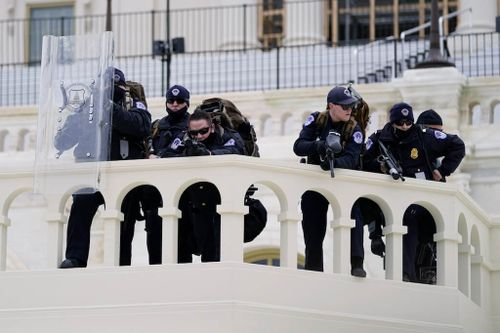 Police Officer's Death Intensifies US Capitol Siege Questions