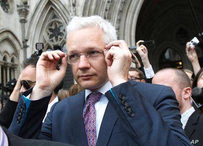 WikiLeaks founder Julian Assange leaves the High Court in London, England, July 13, 2011. (Reuters)
