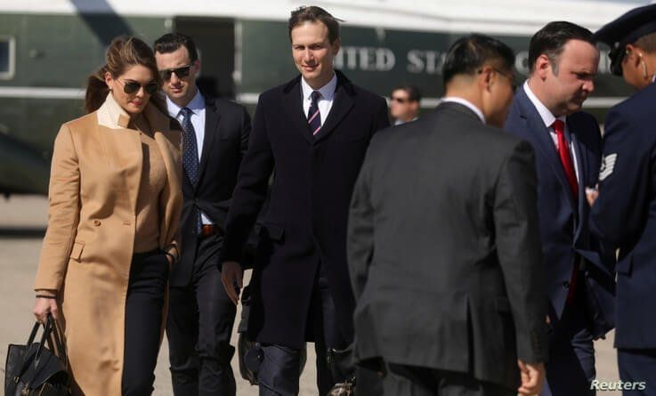 Hope Hicks, (L), an advisor to U.S. President Donald Trump, White House staffers walk to Air Force One to depart Washington.