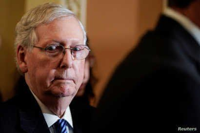 FILE PHOTO: Senate Majority Leader Mitch McConnell (R-KY) speaks to the media after the weekly policy luncheons on Capitol Hill…