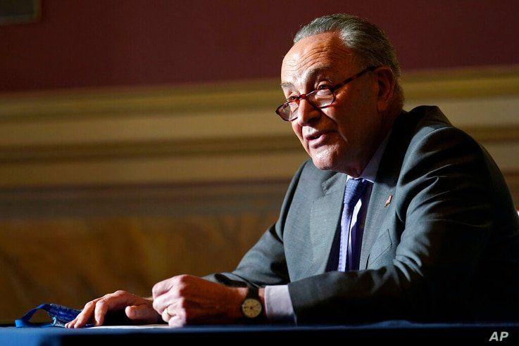 Senate Minority Leader Sen. Chuck Schumer of N.Y., speaks to reporters on Capitol Hill in Washington, Wednesday, Dec. 30, 2020,…