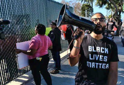 Protestors with Black Lives Matter protest a visit by Democratic presidential candidate and former South Bend, Ind., Mayor Pete…