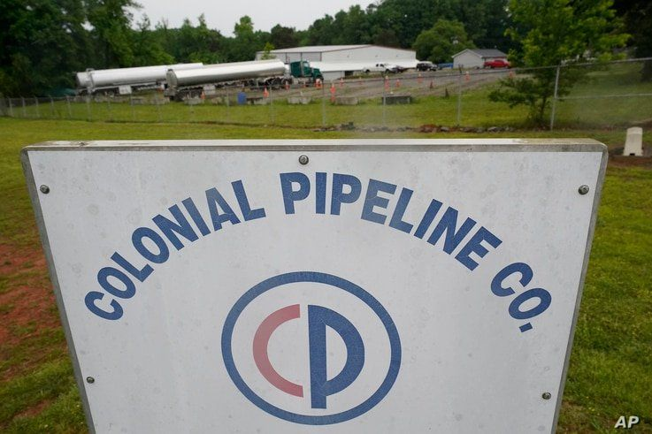 Tanker trucks are parked near the entrance of Colonial Pipeline Company Wednesday, May 12, 2021, in Charlotte, N.C.  Several…