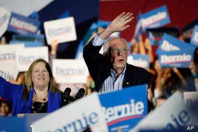 Democratic presidential candidate Sen. Bernie Sanders, I-Vt., right, with his wife Jane, speaks during a campaign event in San…