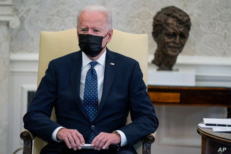 President Joe Biden speaks during a meeting with members of the Congressional Hispanic Caucus, in the Oval Office of the White…